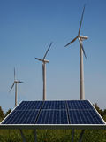 Wind turbines and solar panels Stock Images