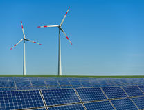 Wind turbines and solar panels in a field Stock Images