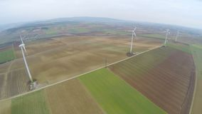 Wind turbines spinning on beautiful green fields, countryside. Renewable energy. Stock footage stock video footage