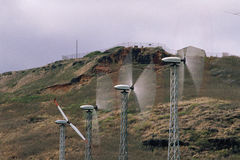 Wind turbines with spinning blades Stock Image