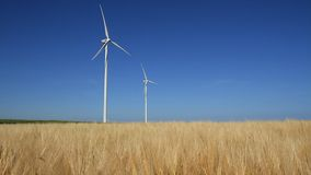 Wind turbines spinning stock footage