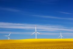 Wind turbines on spring field. Alternative, clean energy Royalty Free Stock Photography