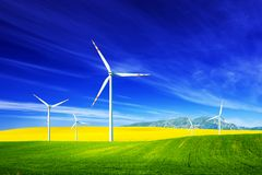 Wind turbines on spring field. Alternative, clean energy stock image