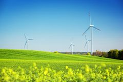 Wind turbines on spring field. Natural energy. Wind turbines on spring field. Alternative, clean and natural source of energy is gaining pupularity. Eco farm Stock Photo