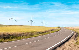 Wind turbines on summer field, green energy. Royalty Free Stock Photo