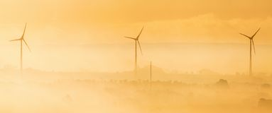 Wind turbines in sunrice Royalty Free Stock Image