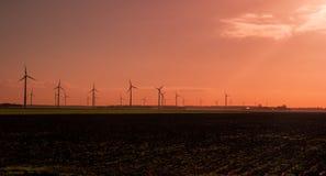 Wind turbines at sunrise Stock Photos