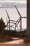 Wind Turbines at Sunrise 6. Wind turbines in hilly landscape Stock Photos