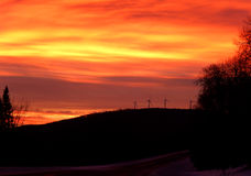 Wind Turbines at Sunrise in Vermont Mountains. Beautiful sunrise over Vermont mountains with wind turbines in silhouette. Gorgeous colors, orange, pink, yellow Royalty Free Stock Image