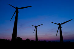 Wind turbines at sunset Stock Photo