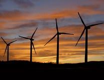 Wind turbines at sunset stock photos