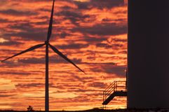 Wind turbines at sunset, wind energy royalty free stock photography