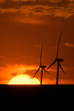 Wind turbines at sunset Royalty Free Stock Photo