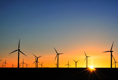 Wind turbines at sunset Stock Image