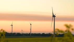 Wind turbines at sunset, green energy. 4K stock footage