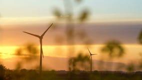 Wind turbines at sunset, green energy. 4K stock video