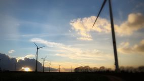 Wind turbines during sunset. Group of wind turbines during sunset stock photography