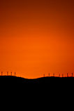 Wind turbines sunset. Wind turbines on a mountain top at sunset Stock Images