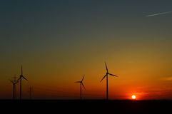 Wind turbines in the sunset Royalty Free Stock Photos