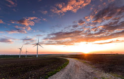 Wind turbines the sunset! Stock Images