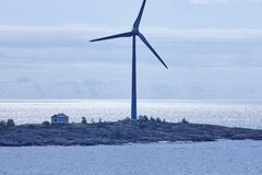 Wind turbines at sunset. Renewable energy. Finland seascape. Horizontal Stock Photos