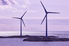 Wind turbines at sunset. Renewable energy. Finland seascape. Horizontal Stock Images