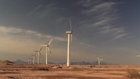 Wind turbines at sunset sky background stock footage