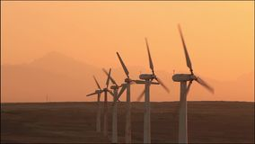 Wind turbines at sunset sky background stock video