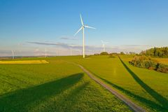 Wind turbines during sunset taken from the drone royalty free stock photo