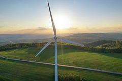 Wind turbines at sunset taken from the drone royalty free stock image