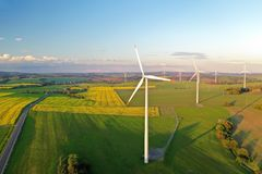 Wind turbines at sunset taken from the drone stock photos