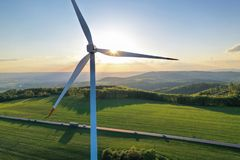 Wind turbines at sunset taken from the drone stock photography