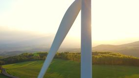 Wind turbines at sunset taken from the drone stock video footage