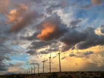 Wind turbines at sunset on a wind energy farm Royalty Free Stock Photography