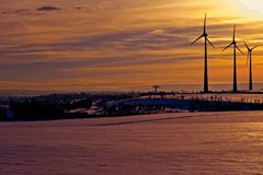 Wind turbines in the sunset on a winter day Royalty Free Stock Photo