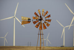 Wind turbines surround windmill Royalty Free Stock Photos