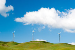 Wind turbines. Three wind turbines in a rural landscape in Sicily Stock Images