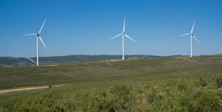 Wind turbines on top of hill in the countryside Royalty Free Stock Image