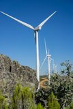 Wind turbines, track and rocks in the countryside Stock Photography