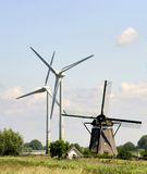 Wind turbines and traditional Dutch windmill Stock Photo