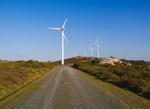 Wind turbines and trail Royalty Free Stock Photography