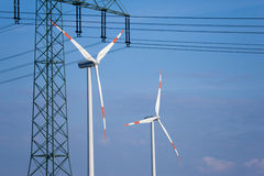 Wind turbines and transmission line. Wind turbines and in the foreground a power transmission line royalty free stock images