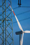 Wind turbines and transmission line Stock Images