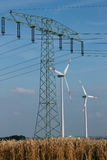 Wind turbines and transmission line Stock Photos
