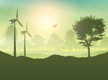Wind turbines and tree landscape Stock Photography