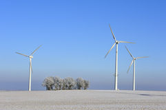 Wind turbines and trees in winter Stock Images