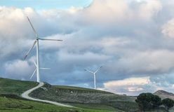 Wind turbines. A wind turbine in beautiful sunset Stock Images