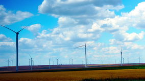 Wind Turbines With Turquoise Sky, Green Energy. Time Lapse, Pan. Concept Of Using Natural Resources Intelligently. Wind energy turbines are one of the stock footage