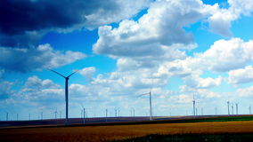 Wind Turbines With Turquoise Sky, Green Energy. Time Lapse, Static Shot. Concept Of Using Natural Resources Intelligently. Wind energy turbines are one of the stock footage