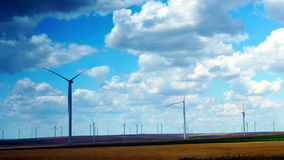 Wind Turbines With Turquoise Sky, Green Energy. Time Lapse, Zoom In. Concept Of Using Natural Resources Intelligently. Wind energy turbines are one of the stock video